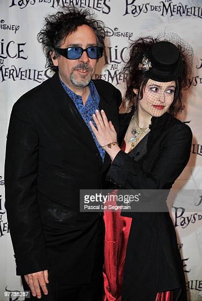 Director Tim Burton and actress Helena Bonham Carter arrive for the premiere of Burton's film 'Alice au pays des merveilles' at Theatre Mogador on...