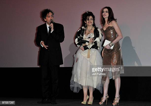 Director Tim Burton and actresses Helena Bonham Carter and Anne Hathaway onstage ahead of the Royal World Premiere of Tim Burton's 'Alice In...