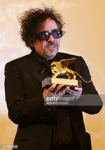 """Director Tim Burton poses with his Golden Lion for lifetime achievement award before the screening of """"The Nightmare Before Christmas 3-D"""" during the..."""