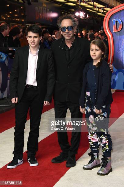 Director Tim Burton with children Billy and Nell attend the 'Dumbo' European premiere at The Curzon Mayfair on March 21 2019 in London England