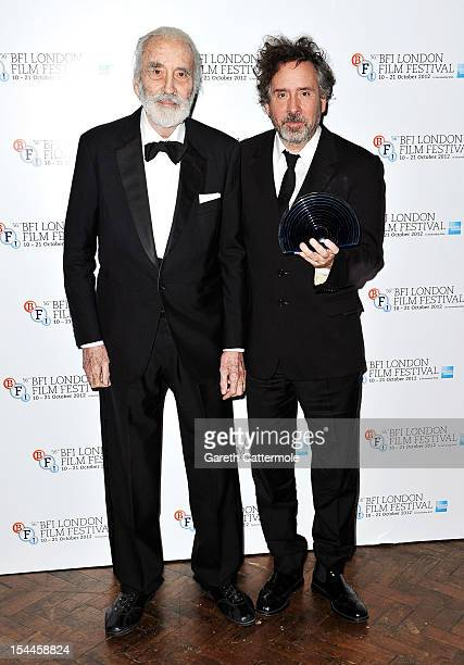 Director Tim Burton with his BFI Fellowship award with actor Christopher Lee during the 56th BFI London Film Festival Awards at the Banqueting House...