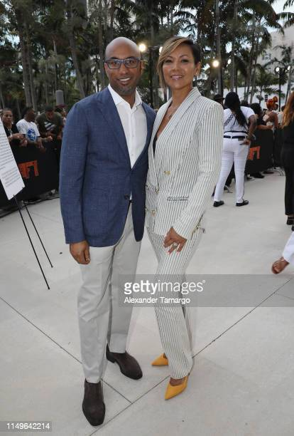 "Director Tim Story and his wife attend the ""Shaft"" Opening Night Premiere of The American Black Film Festival on June 12, 2019 in Miami, Florida."