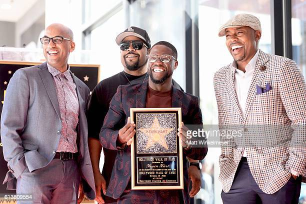 Director Tim Story rapper/actor Ice Cube actor/comedian Kevin Hart and producer Will Packer pose for a photo as Kevin Hart is honored with a star on...