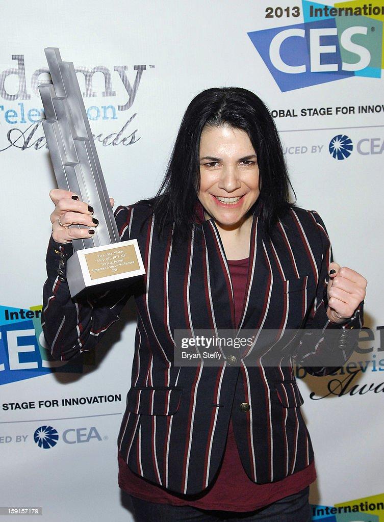 Director Tina Cesa Ward poses with the IAWTV award for Best Drama Directing at the IAWTV Awards at the CES 2013 Show at the Palazzo Theater at the Palazzo Resort Hotel/Casino on January 8, 2013 in Las Vegas, Nevada.
