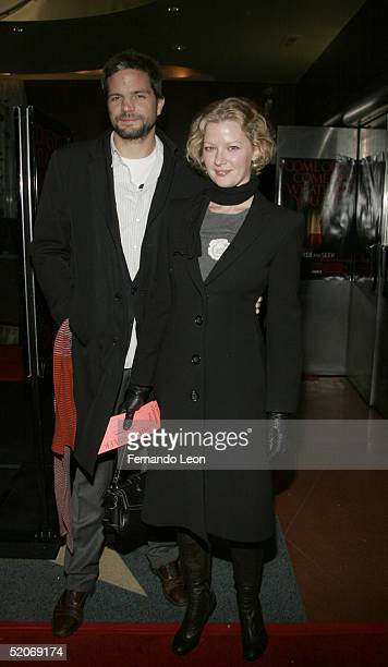 Director Tod Williams and actress Gretchen Mol pose for a photo upon arriving to the premiere of 'Hide And Seek' at the Beekman theater on January 26...