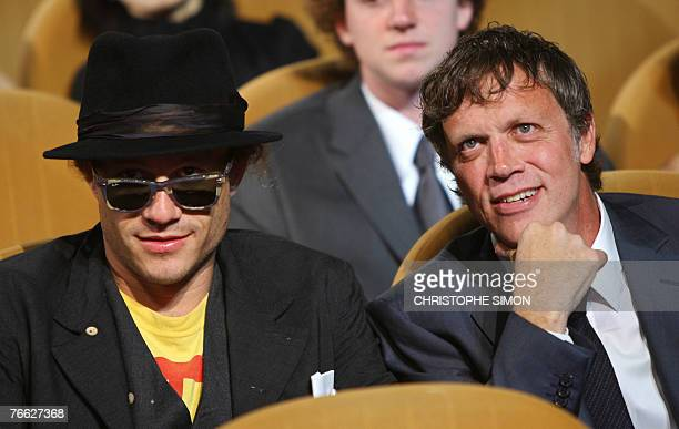 US director Todd Haynes speaks with US actor Heath Ledger before receiving his special jury award during the closing ceremony of the 64th Venice...