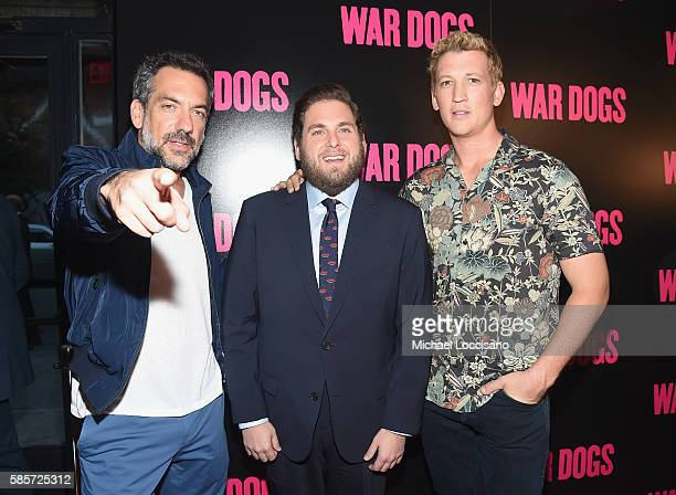 Director Todd Phillips actors Jonah Hill and Miles Teller attend the War Dogs New York Premiere at Metrograph on August 3 2016 in New York City
