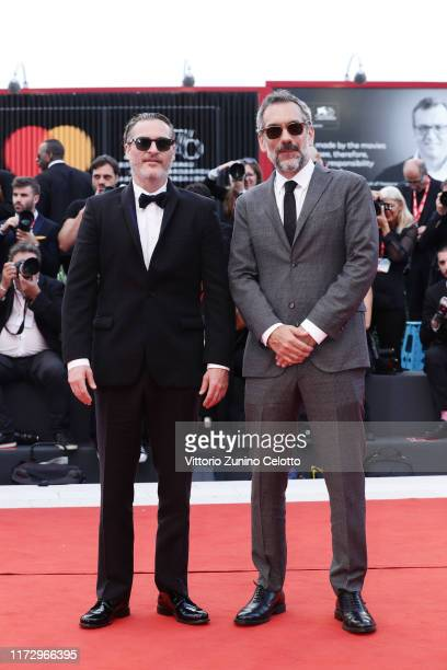 Director Todd Phillips and Joaquin Phoenix of The Joker walks the red carpet ahead of the closing ceremony of the 76th Venice Film Festival at Sala...