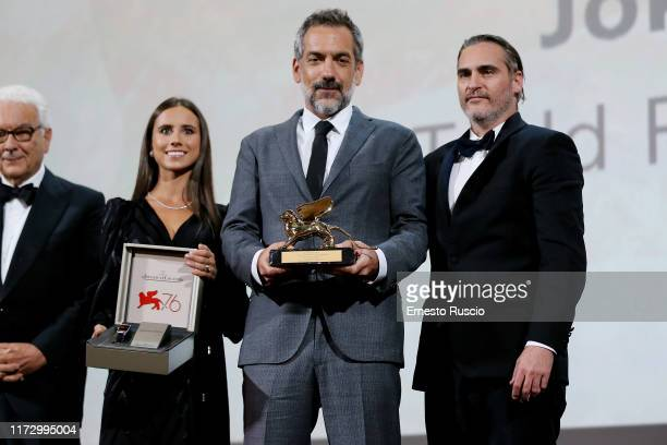Director Todd Phillips receive the Golden Lion for Best Film Award for 'Joker' from Biennale Director Paolo Baratta with Joaquin Phoenix during the...