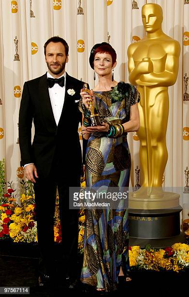 Director Tom Ford and designer Sandy Powell winner of the Best Costume Design Award for 'The Young Victoria' pose in the press room at the 82nd...
