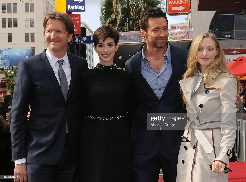 Director Tom Hooper, actress Anne Hathaway, actor Hugh Jackman and actress Amanda Seyfried participate in the Hugh Jackman Star ceremony at The Hollywood Walk Of Fame on December 13, 2012 in Hollywood, California.