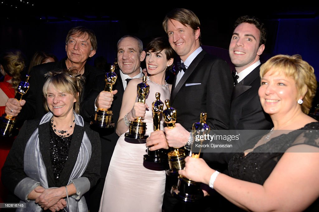 Director Tom Hooper (3rd from R), Actress Anne Hathaway (C) , winner of the Best Supporting Actress, Sound engineers Andy Nelson (2nd from L), Simon Hayes (3rd from R) and Mark Paterson (2nd from L), winners of the Best Sound Mixing, Makeup artists Lisa Westcott (L) and Julie Dartnell (R), winners of the Best Makeup and Hairstyling for 'Les Miserables' attend the Oscars Governors Ball at Hollywood & Highland Center on February 24, 2013 in Hollywood, California.