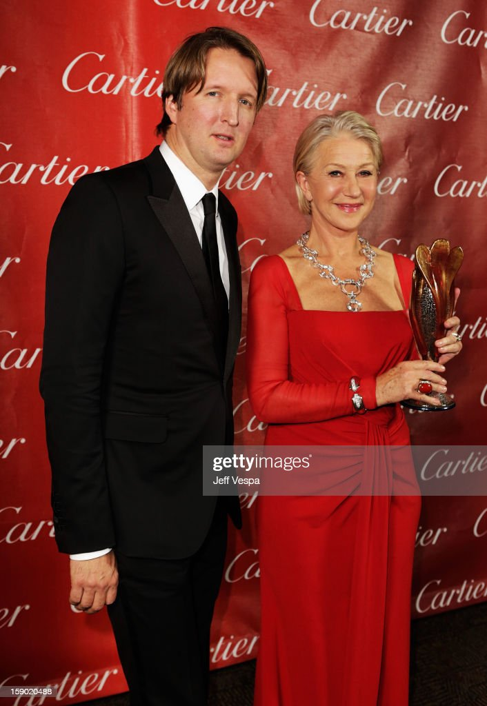 Director Tom Hooper and Dame Helen Mirren pose with the International Star Award at the 24th annual Palm Springs International Film Festival Awards Gala at the Palm Springs Convention Center on January 5, 2013 in Palm Springs, California.
