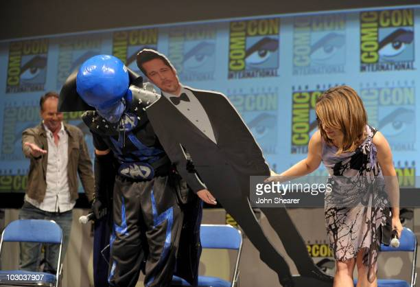 """Director Tom McGrath, actor Will Ferrell, cardboard cut-out of Brad Pitt and actress Tina Fey take a bow at the """"Megamind"""" panel during Comic-Con..."""