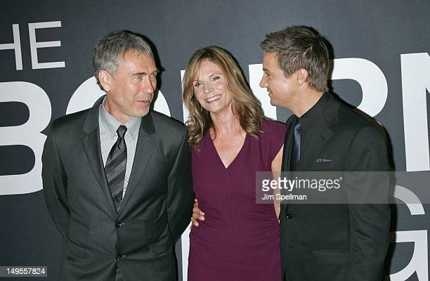 Director Tony Gilroy with wife Susan Gilroy and actor Jeremy Renner at The Bourne Legacy New York Premiere at Ziegfeld Theater on July 30 2012 in New...