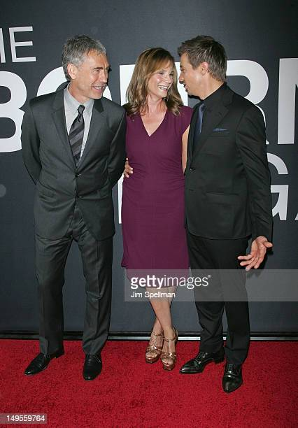 Director Tony Gilroy with wife Susan Gilroy and actor Jeremy Renner attend The Bourne Legacy New York Premiere at Ziegfeld Theater on July 30 2012 in...