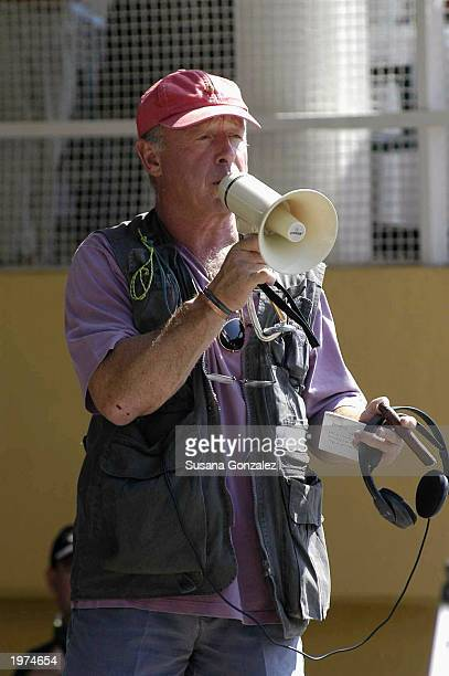 Director Tony Scott talks to cast and crew while filming a scene of Man On Fire at a sports club May 5 2003 in Mexico City Mexico