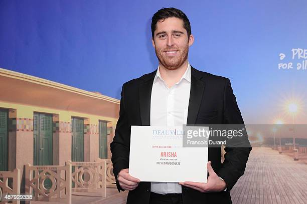 Director Trey Edward Shults poses with the Critics' Prize for his movie Krisha at the end of the 41st Deauville American Film Festival on September...