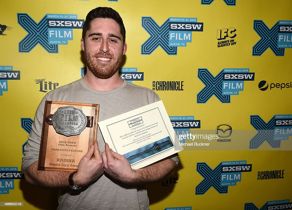 Director Trey Edward Shults poses with the Grand Jury Award for Narrative Feature during the SXSW FIlm Awards at the 2015 SXSW Music, FIlm + Interactive Festival at the Paramount Theatre on March 17, 2015 in Austin, Texas.