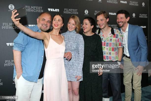Director Uli Edel Aylin Tezel Leonie Benesch Sarah Kirkegaard Jonas Nay and Oliver Berben take a selfie during Der Club der singenden Metzger...