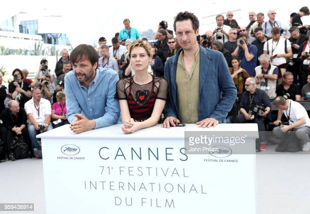 Director Ulrich Kohler actress Elena Radonicich and actor Hans Low attend the 'In My Room' Photocall during the 71st annual Cannes Film Festival at...