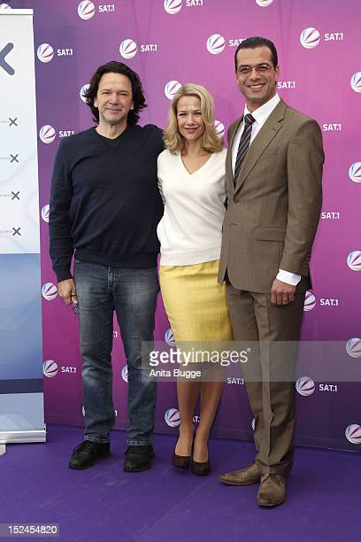 Director Uwe Janson actress Alexandra Neldel and actor Kai Schumann attend the 'Der Minister' photocall on September 21 2012 in Berlin Germany