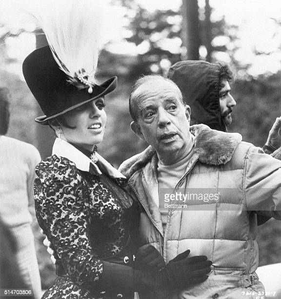 """Director Vincente Minnelli discusses a scene with his daughter, Liza, on the set of his film """"A Matter of Time,"""" in which she is starring."""