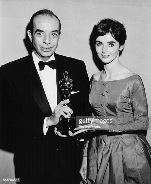 Director Vincente Minnelli holding his Oscar for the film 'Gigi' with presenter Millie Perkins at the 31st Academy Awards Los Angeles April 6th 1959
