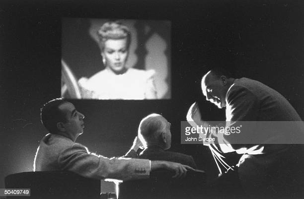 Director Vincente Minnelli with producer John Houseman and unidentified, animatedly discussing their film The Bad and the Beautiful with Lana Turner,...