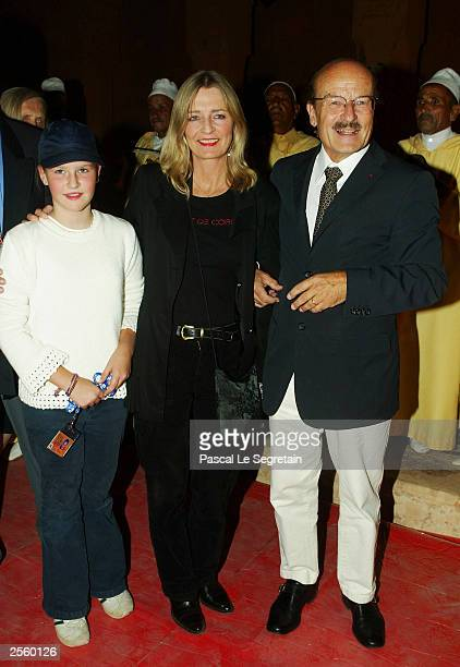 Director Volker Schlondorff his wife Angelika and his Daughter Helena arrive at the opening ceremony of the Marrakech Film Festival October 3 2003 at...