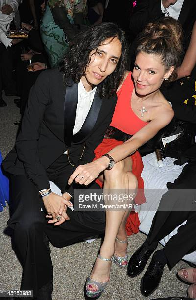 Director Voula Wolf Duval and Andrea Dibelius attend the 2012 amfAR's Cinema Against AIDS after party during the 65th Annual Cannes Film Festival at...
