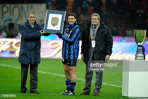 Director Walter Gagg Inter Club President Massimo Moratti and Inter Club Captain Javier Zanetti pose during the presentation of the FIFA Club World...