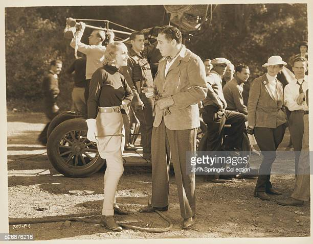 Director Walter Lang discusses an action scene with Carole Lombard on the set of the 1936 movie Love Before Breakfast