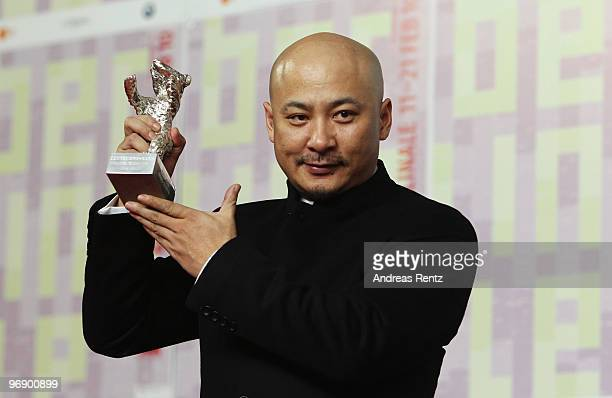 Director Wang Quan'an poses with the Silver Bear for Best Script of 'Tuan Yuan' at the 'Award Winners' Photocall during day ten of the 60th Berlin...