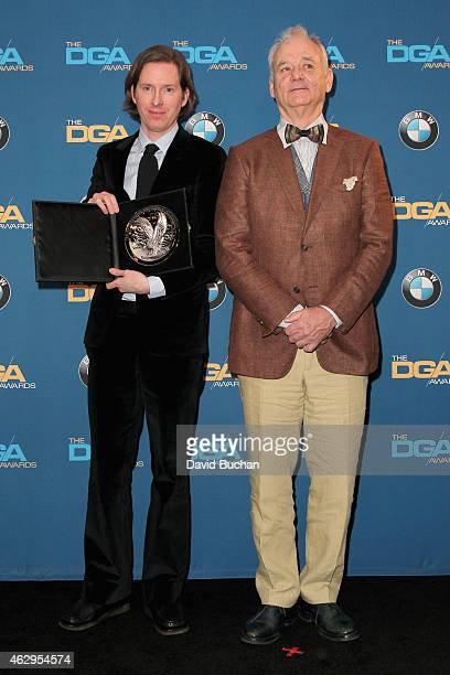 """Director Wes Anderson , recipient of the Feature Film Nomination Plaque for """"The Grand Budapest Hotel,"""" poses with actor Bill Murray in the press..."""