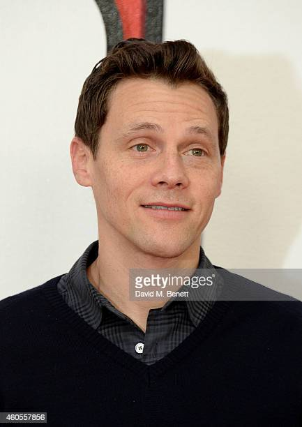 """Director Will Gluck attends a photocall for """"Annie"""" at Corinthia Hotel London on December 16, 2014 in London, England."""
