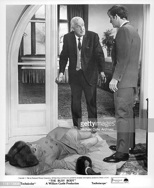 Director William Castle rehearses Anne Baxter and Sid Caesar for a scene from the film 'The Busy Body' 1966