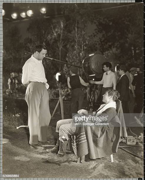 Director William Dieterle and comedian Joe E Brown on the set of A Midsummer Night's Dream