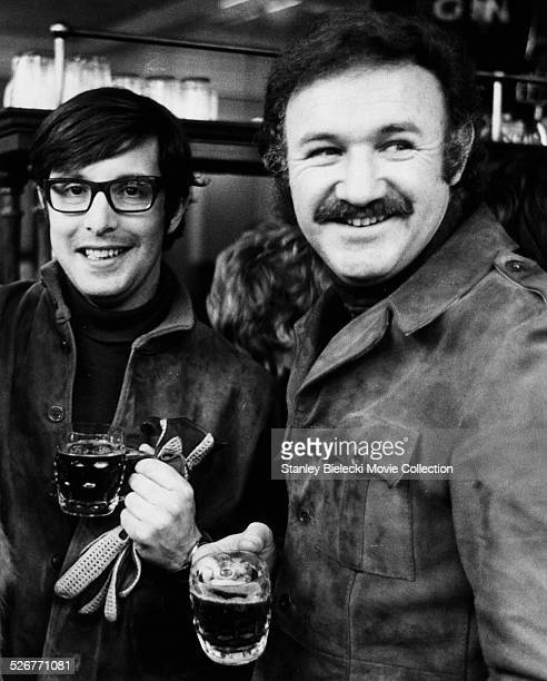Director William Friedkin and actor Gene Hackman drinking beer from tankards on the set of the movie 'The French Connection' 1971