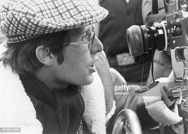 Director William Friedkin looks through the camera on the set of The Exorcist