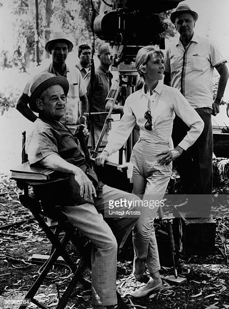 Director William Wyler and actress Audrey Hepburn on the set of the film 'The Children's Hour' 1961 The man on the right may be cinematographer Franz...