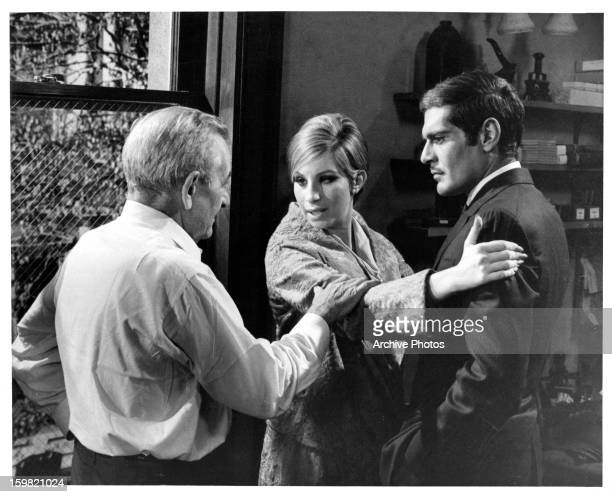 Director William Wyler rehearses scene with Barbra Streisand and Omar Sharif on the set of the film 'Funny Girl' 1968