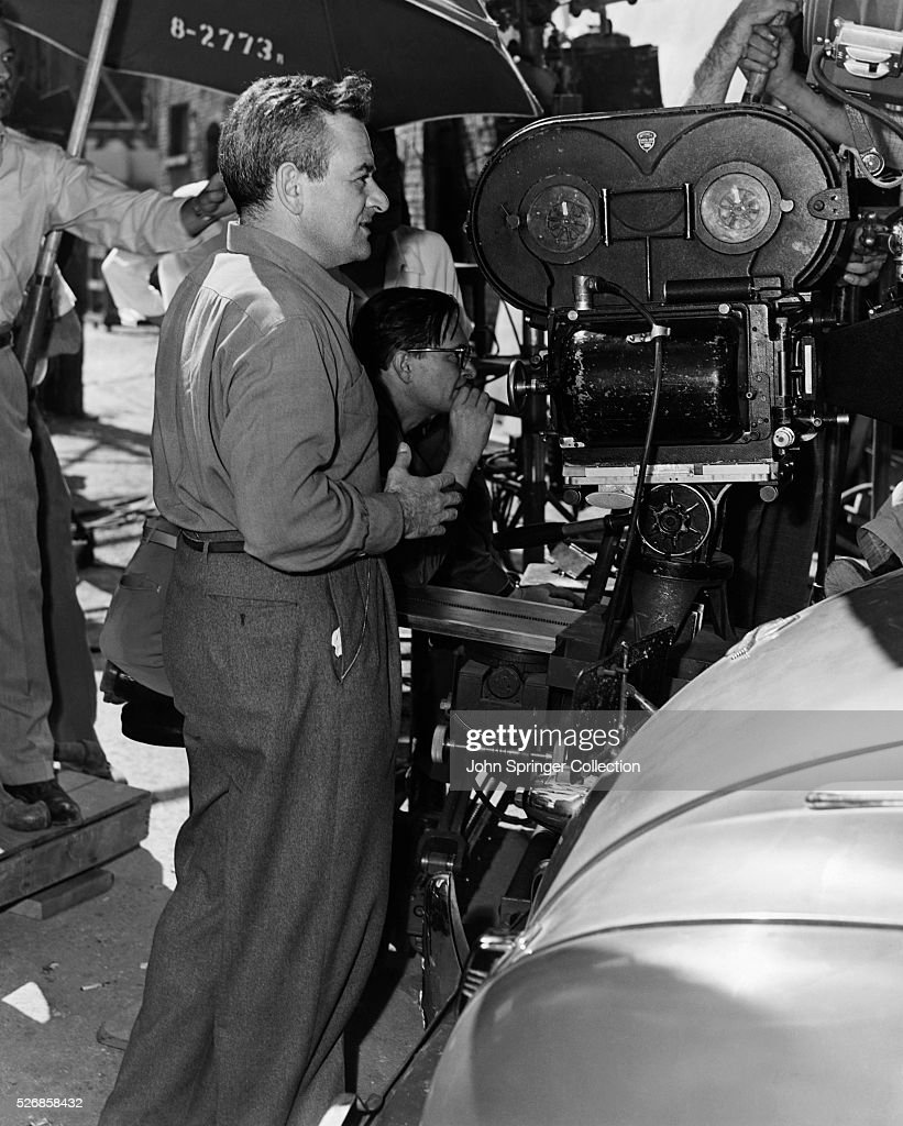 Director William Wyler stands by cameraman Gregg Toland during a scene shoot for the 1964 motion picture The Best Years of Our Lives.