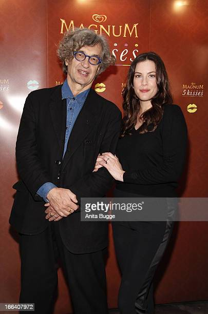 Director Wim Wenders and actress Liv Tyler pose for the press prior to the press conference to promote the 'Magnum 5 Kisses' commercial at Soho House...