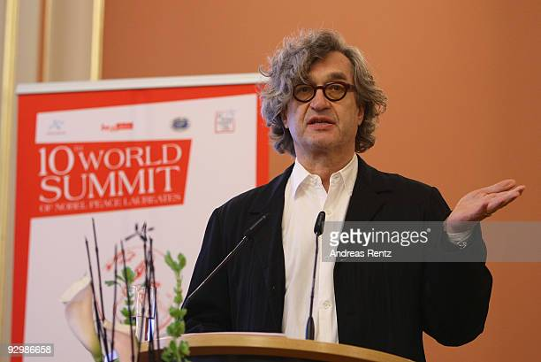 Director Wim Wenders speaks on the second day of the 10th World Summit of Nobel Peace Laureates at Berlin town hall on November 11 2009 in Berlin...