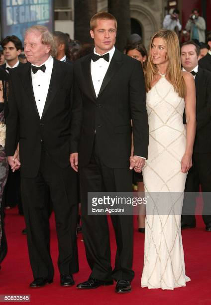 Director Wolfgang Petersen actor Brad Pitt and his wife actress Jennifer Aniston attend the World Premiere of the epic movie Troy at Le Palais de...