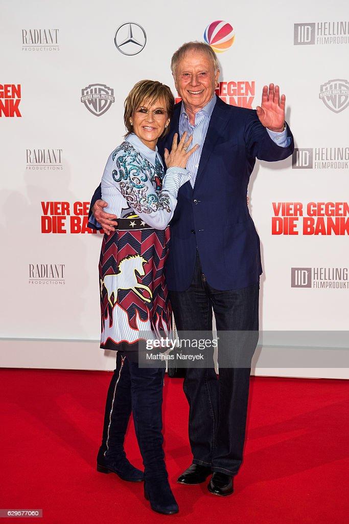 Director Wolfgang Petersen and his wife Maria Borgel-Petersen attend the German premiere of the film 'Vier gegen die Bank' at CineStar on December 13, 2016 in Berlin, Germany.