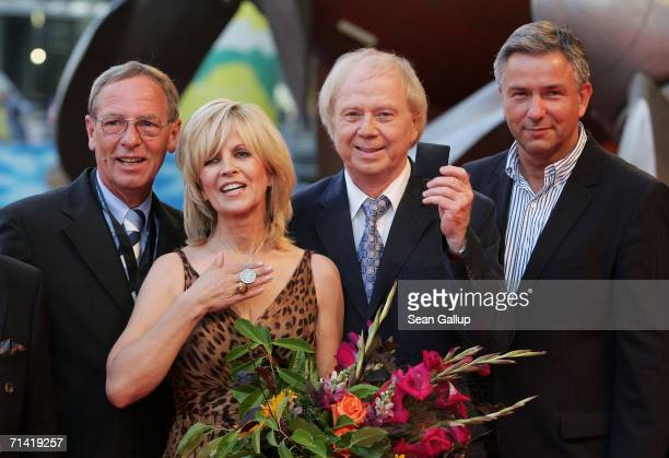 """Director Wolfgang Petersen , his wife Maria and Berlin mayor Klaus Wowereit arrive at the German premiere of """"Poseidon"""" July 11, 2006 at the..."""
