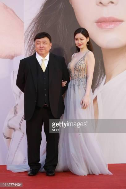 Director Wong Jing and actress Sabrina Qiu Yinong pose on the red carpet of the 38th Hong Kong Film Awards Ceremony at the Hong Kong Cultural Centre...
