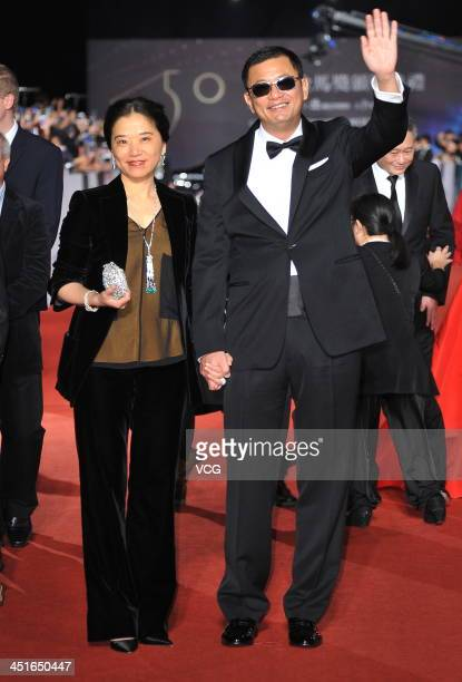 Director Wong Karwai and his wife arrive on the red carpet of the 50th Golden Horse Awards at Sun Yatsen Memorial Hall on November 23 2013 in Taipei...